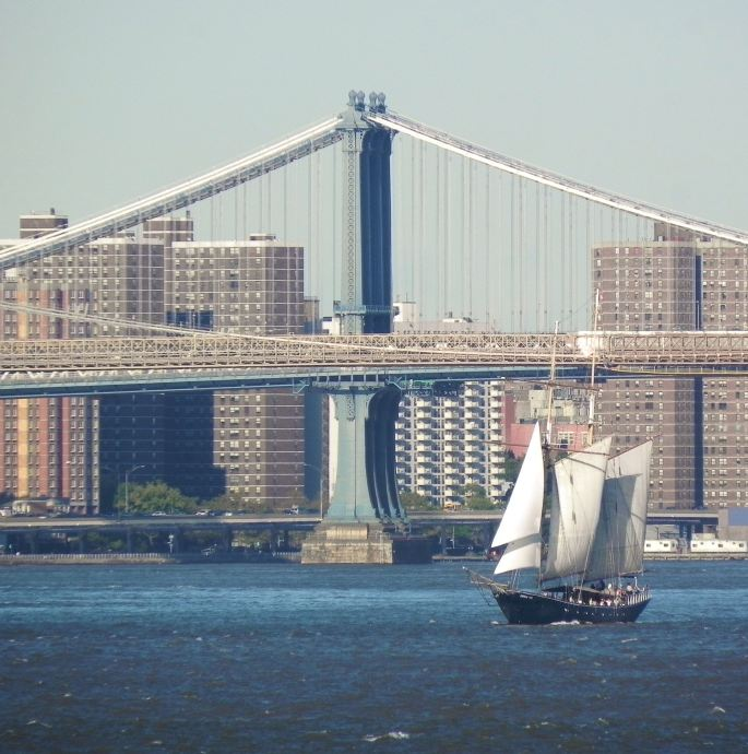 Sail boat with Brooklyn Bridge in background.