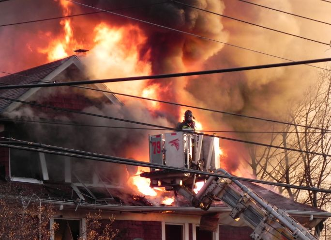 Fireman fighting fire in Staten Island.